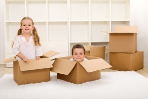 2-kids-playing-in-boxes-300x200